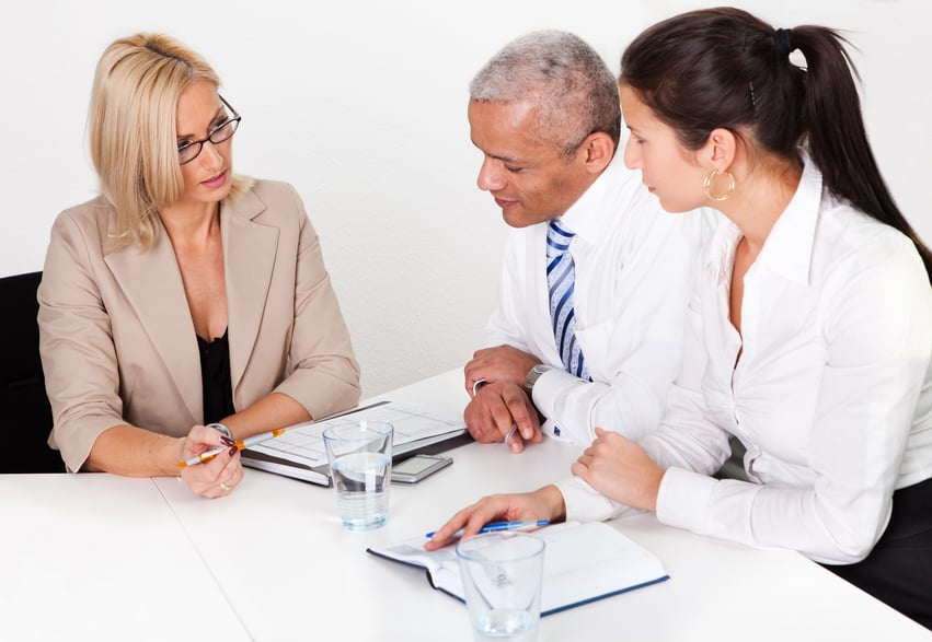 Business consultant advising business people in the meeting
